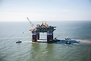 "Chevron's deepwater offshore oil platform ""JACK/ST. MALO"" being towed offshore from Kiewit in Ingleside, Texas by Crowley Maritime Corporation's OCEAN CLASS Tugs. (Aerial Photography by Tim Burdick)"