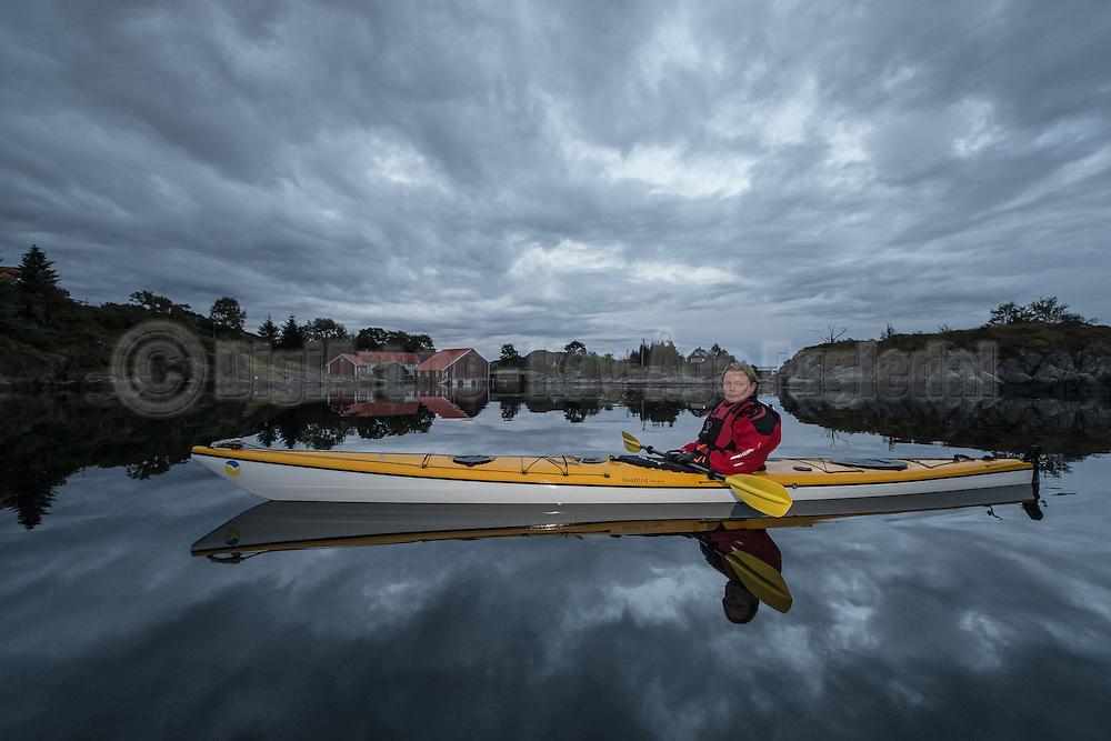 A Kayaker in nice environment with calm sea and nice sky. Approved by person for internet posting | Kajakkpadler i pent miljø med stille sjø og pen himmel. Godkjendt av person for internett.