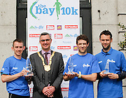 No fee for Repro: Dun Laoghaire-Rathdown County Council, Cathaoirleach Cllr Tom Joyce, pictured with (from left) Jason Fahy winner of the DLR Bay 10K road race in 32 minutes and 20 seconds with Eoin Brennan second place and Stephen Moore third place. Pic Jason Clarke Photography