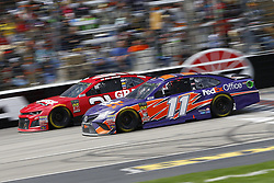 April 8, 2018 - Ft. Worth, Texas, United States of America - April 08, 2018 - Ft. Worth, Texas, USA: Ryan Newman (31) and Denny Hamlin (11) battle for position during the O'Reilly Auto Parts 500 at Texas Motor Speedway in Ft. Worth, Texas. (Credit Image: © Chris Owens Asp Inc/ASP via ZUMA Wire)