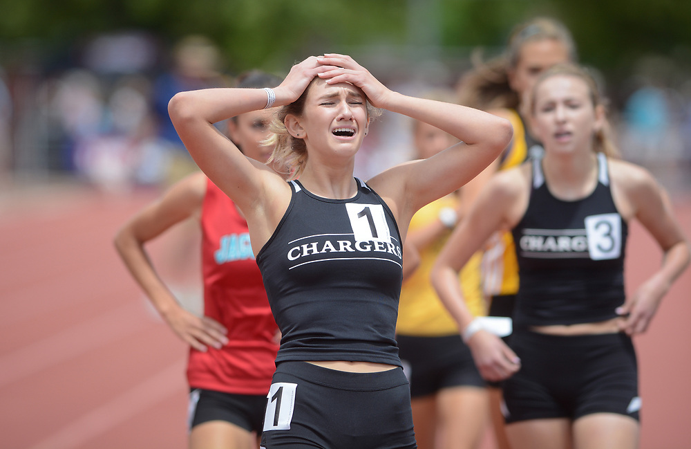 mkb051317o/sports/Marla Brose --  Albuquerque Academy's Grace Alley, front left, reacts after winning the 5A 800 meter run on the final day of the NMAA State Track & Field Championships, Saturday, May 13, 2017, in Albuquerque, N.M.  (Marla Brose/Albuquerque Journal)