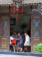 An elderly man smiling at camera in China.