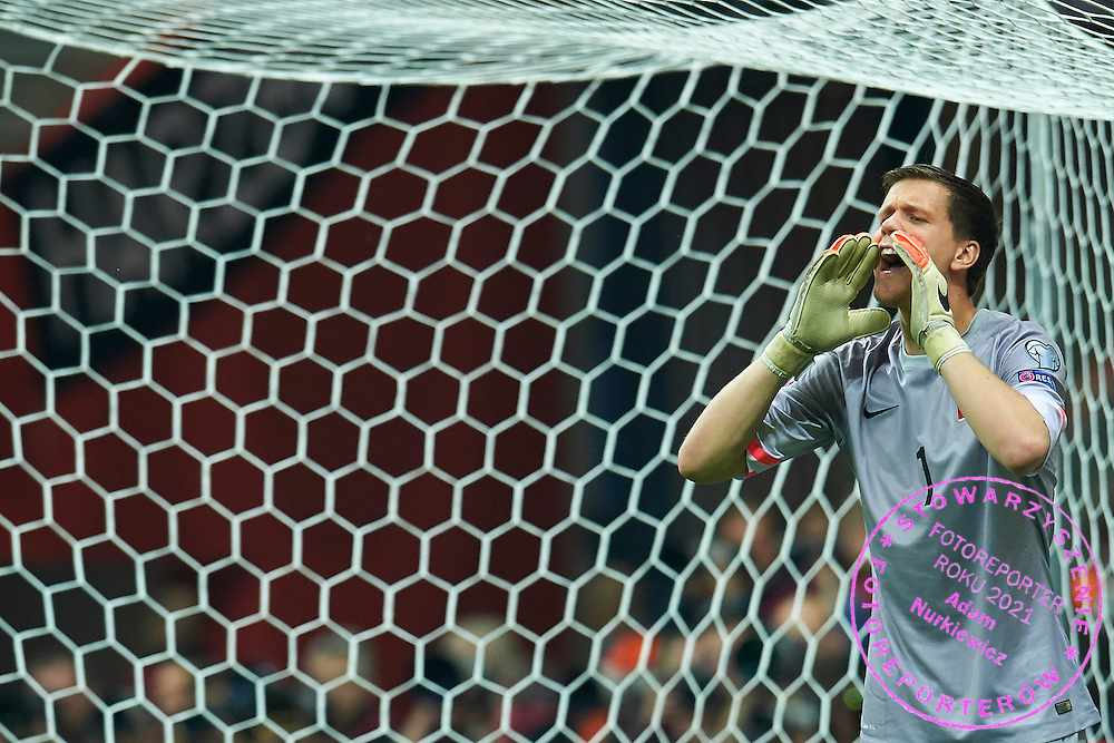 Poland's goalkeeper Wojciech Szczesny shouts during the EURO 2016 qualifying match between Poland and Germany on October 11, 2014 at the National stadium in Warsaw, Poland<br /> <br /> Picture also available in RAW (NEF) or TIFF format on special request.<br /> <br /> For editorial use only. Any commercial or promotional use requires permission.<br /> <br /> Mandatory credit:<br /> Photo by &copy; Adam Nurkiewicz / Mediasport