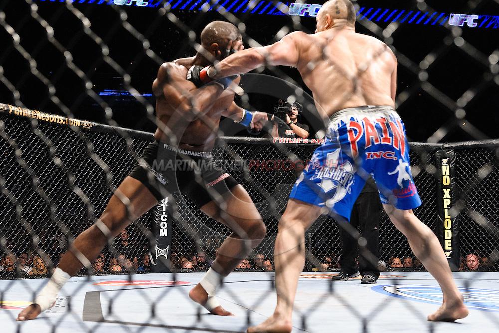 """ATLANTA, GEORGIA, SEPTEMBER 6, 2008: Rashad Evans (left) blocks a punch from Chuck Liddell during """"UFC 88: Breakthrough"""" inside Philips Arena in Atlanta, Georgia on September 6, 2008"""