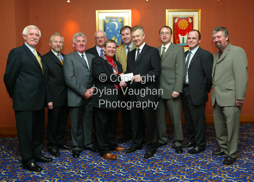 6/12/2002.Pictured at the presentation of a cheque for Û3,000 by the Carlow Kilkenny branch of the Construction Industry Federation to the Carlow Kilkenny Homecare Team at the federations annual dinner dance at the Kilkenny Ormonde Hotel was from left Michael Whelan of Steel and Roofing Systems, Roy Stannard Bord Gas, Paddy Chawke of Hytherm and Extratherm, Henry Corrigan of Chadwicks, Pat Cahill Chairman of the Carlow Kilkenny branch of the Construction Industry Federation, Paul McDonald Century Homes, Ian Wilson Chairman of Carlow Kilkenny Homecare Team, Eddie Deegan AIB Carlow, Mark Bannon of Patterson Bannon Architects and Gerry Kavanagh of Roadstone Provinces..Picture Dylan Vaughan.