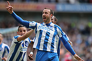Brighton & Hove Albion centre forward Glenn Murray (17) scores a goal 1-0 and celebrates with Brighton & Hove Albion winger Anthony Knockaert (11) during the EFL Sky Bet Championship match between Brighton and Hove Albion and Wigan Athletic at the American Express Community Stadium, Brighton and Hove, England on 17 April 2017.