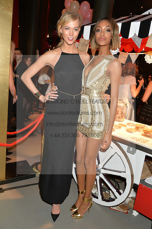 Left to right, KARLIE KLOSS and JOURDAN DUNN at 'The World's First Fabulous Fund Fair' in aid of the Naked Heart Foundation hosted by Natalia Vodianova and Karlie Kloss at The Roundhouse, Chalk Farm Road, London on 24th February 2015.