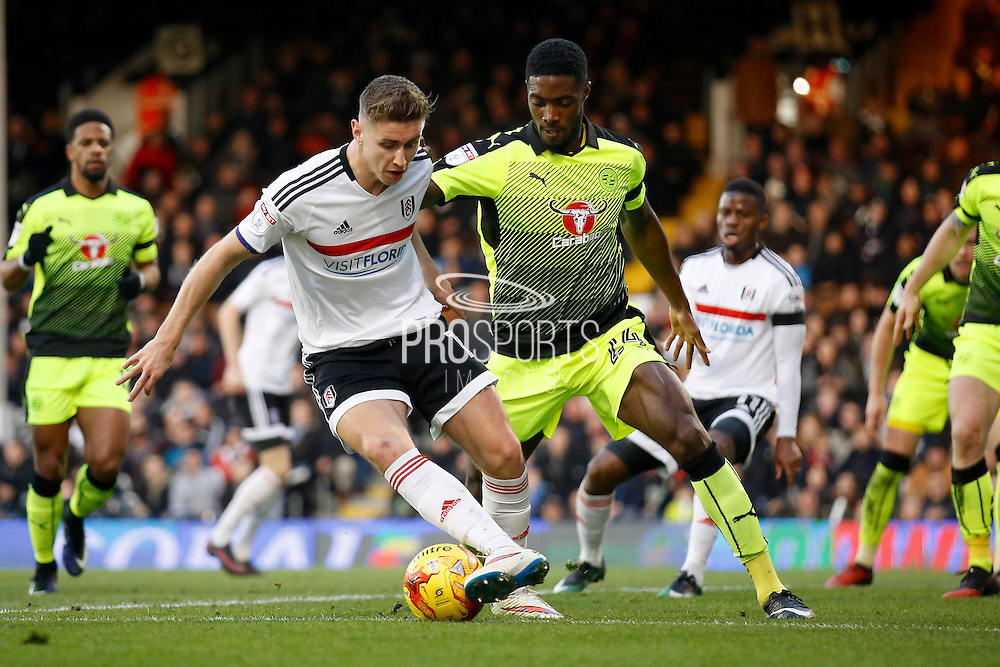 Fulham midfielder Tom Cairney (10) looks to keep the ball from Reading defender Tyler Blackett during the EFL Sky Bet Championship match between Fulham and Reading at Craven Cottage, London, England on 3 December 2016. Photo by Andy Walter.