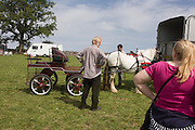 Travellers from across the West Country and beyond try out Romany carriages and horses at the ancient annual Priddy Sheep (and horse) fair in Somerset, England.Set in the Mendip Hills, in the south-western English county of Somerset, the Priddy Sheep fair is host to an odd mix of farmers and travellers (commonly and incorrectly known as gypsies). In this field set aside purely for travellers, many with West Country accents but also with nearby Welsh and Irish too, deals are done with a traditional spit on the hand and a smacking of palms, selling a pony to another family. The Priddy Sheep Fair moved from the city of Wells in 1348 because of the Black Death.