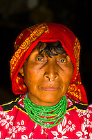 Kuna Indian woman wearing native costume (with nose ring) in her hut, Crab Island (Carti Sugdup), San Blas Islands (Kuna Yala), Caribbean Sea, Panama