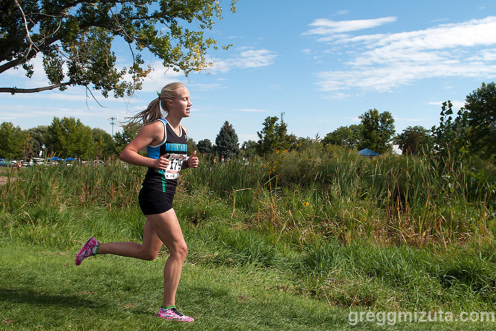 Mountain View junior Holly Ellingson during lap two of Roger Curran 5k varsity race at West Park in Nampa, Idaho on September 14, 2013. Ellingson finished sixth with a time of 21:34.50.