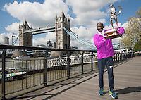 Virgin Money London Marathon 2015<br /> <br /> Winners Photocall<br /> <br /> Left to Right<br /> Eliud Kipchoge Kenya Mens winner<br /> <br /> Posing with the Sporting Life Marathon Trophy<br /> <br /> Photo: Bob Martin for Virgin Money London Marathon<br /> <br /> This photograph is supplied free to use by London Marathon/Virgin Money.