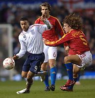 Photo: Paul Greenwood.<br />England v Spain. International Friendly. 07/02/2007. Kieron Dyer, left, gets the better of Carlos Puyol