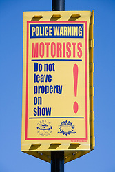 Police warning sign to motorists not to leave property on show in their cars,