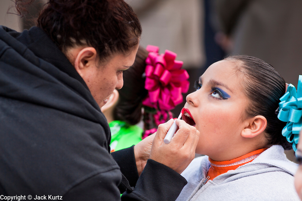 14 FEBRUARY 2012 - PHOENIX, AZ:   LETICIA DILL (left) puts makeup on her daughter, KEANNA DILL, 12, a member of the Ballet Folklorico Esperanza before the group performed at the State Capitol in Phoenix, Feb 14. Arizona's statehood day is February 14 and this year Arizona marked 100 years of statehood. It was the last state in the 48 contiguous United States.   PHOTO BY JACK KURTZ