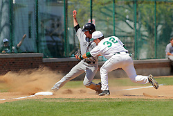 17 April 2016:  A Cardinal runner gets a foot on third base ahead of the tag by Matthew Mardis during an NCAA division 3 College Conference of Illinois and Wisconsin (CCIW) Pay in Baseball game during the Conference Championship series between the North Central Cardinals and the Illinois Wesleyan Titans at Jack Horenberger Stadium, Bloomington IL