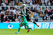 Fabian Schar (#5) of Newcastle United leaps to clear the ball with a header during the Premier League match between Newcastle United and Watford at St. James's Park, Newcastle, England on 31 August 2019.