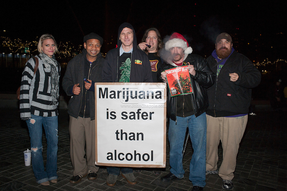December 6, 2012. Seattle, Washington. Washington and Colorado became the first states to vote to decriminalize and regulate the possession of an ounce or less of marijuana by adults over 21. Pictured revelers at a 'Stash Mob' gathering in Seattle...Photo © John Chapple / www.JohnChapple.com