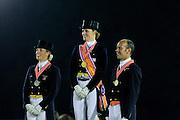 Podium Nederlands Kampioenschap 1. Madeleine Witte Vrees, 2. Joyce Heuitink, 3. Hans Peter Minderhoud<br /> Nederlandse Kampioenschappen 2010<br /> © DigiShots