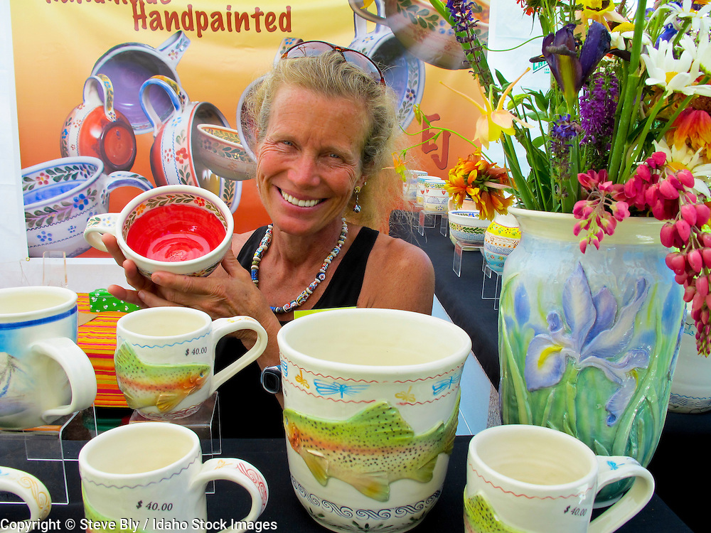 Idaho, Artisan selling her  handpainted pottery during the Ketchum-Sun Valley Arts & Crafts Show.