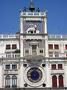 St Mark's Clock tower  Venice. The early renaissance building is on the North side of the Piazza San Marco at the entrance to the Merceira. It is comprised of a tower and two lower buildings either side.