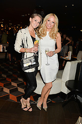 Left to right, JUDE CISSE and LIZ McCLARNON at a party to celebrate the publication of Behind The Mask by Emma Sayle held at The Playboy Club, 14 Old Park Lane, London on 23rd April 2014.