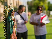 "19 JULY 2012 - PHOENIX, AZ:  People pray for justice during a vigil at the Arizona State Capitol on the first day of a class action lawsuit, Melendres v. Arpaio in Phoenix Thursday. The suit, brought by the ACLU and MALDEF in federal court against Maricopa County Sheriff Joe Arpaio, alleges a wide spread pattern of racial profiling during Arpaio's ""crime suppression sweeps"" that targeted undocumented immigrants. U.S. District Judge Murray Snow granted the case class action status opening it up to all Latinos stopped by Maricopa County Sheriff's Office deputies during the crime sweeps. The case is being heard in Judge Snow's court.  PHOTO BY JACK KURTZ"