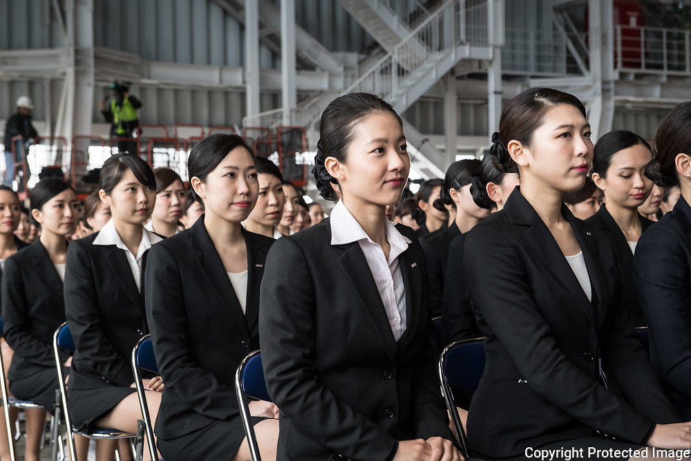 Newly hired employees attend the welcome ceremony of ANA Holdings Inc. at the company's hanger on April 1, 2017 in Tokyo, Japan. Japanese airlines ANA Holdings welcomed 2,800 new employees, the largest number to date for the company. As the majority of Japanese start their career on April 1st after graduating from schools in February or March, it is a custom for large Japanese corporations to hold mass welcoming ceremonies for their new employees. 1/04/2017-Tokyo, JAPAN