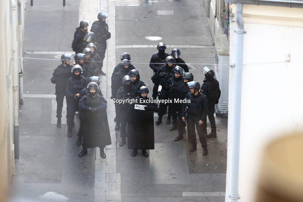EXCLUSIVE<br /> POLICE GET READY TO STORM FLAT IN PARIS WHERE MAN WAS ARREST AND WOMAN KILLED HERSELF<br /> &copy;Exclusivepix Media