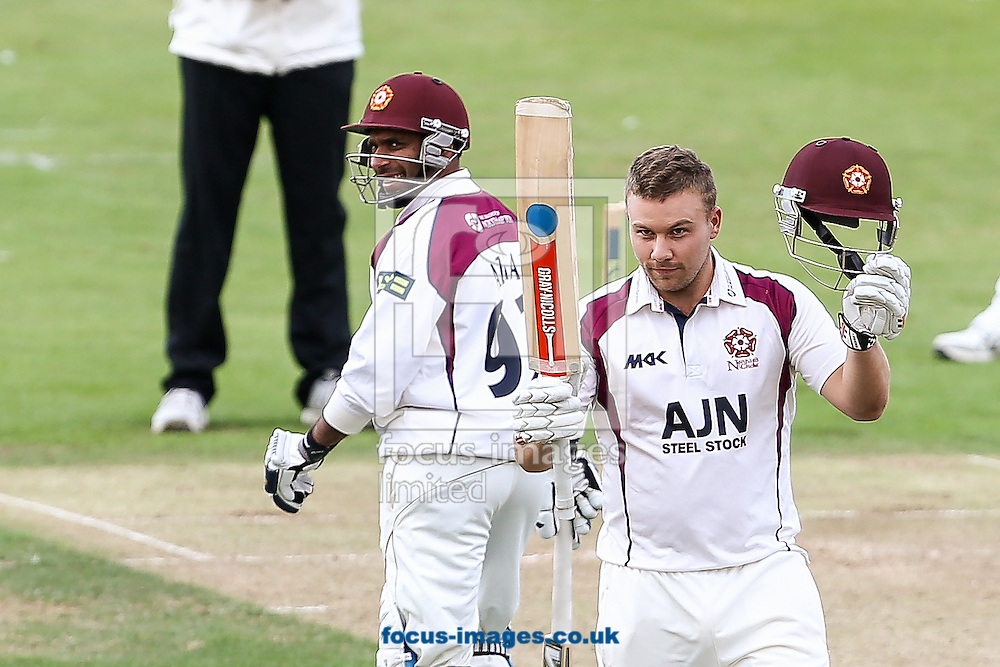 Adam Rossington of Northamptonshire County Cricket Club (right) acknowledges the applause on reaching his century during the LV County Championship Div One match at the County Ground, Northampton.<br /> Picture by Andy Kearns/Focus Images Ltd 0781 864 4264<br /> 15/08/2014