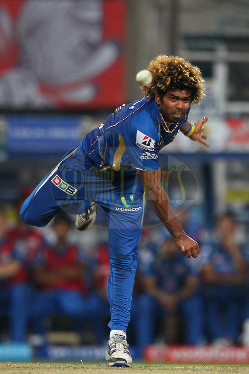 Lasith Malinga bowls but the ball slips from his hand during the 2nd Qualifying match of the Pepsi Indian Premier League between The Rajasthan Royals and the Mumbai Indians  held at the Eden Gardens Stadium in Kolkata on the 24th May 2013..Photo by Ron Gaunt-IPL-SPORTZPICS      ..Use of this image is subject to the terms and conditions as outlined by the BCCI. These terms can be found by following this link:..http://www.sportzpics.co.za/image/I0000SoRagM2cIEc
