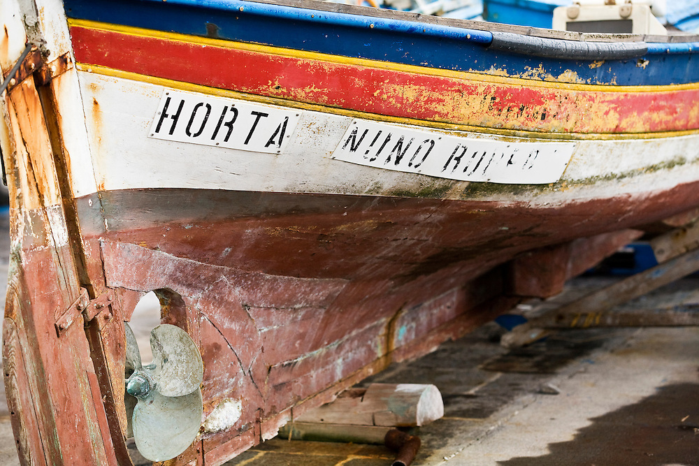 A fishing boat is left on the public dock of the  harbor of Horta on the island of Faial. One of of the Azores,  a group of islands in the Atlantic that are a part of Portugal and the European Union. Horta is a popular stop for yachts crossing the Atlantic in the Spring time to return to Europe.