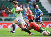 LONDON, ENGLAND - Saturday 10 May 2014, Kwagga Smith of South Africa is caught by Francisco Almeida of Portugal during the match between South Africa and Portugal at the Marriott London Sevens rugby tournament being held at Twickenham Rugby Stadium in London as part of the HSBC Sevens World Series.<br /> Photo by Roger Sedres/ImageSA