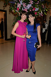 Left to right, ballerinas LAUREN CUTHBERTSON and NATALIA OSIPOVA at a dinner hosted by the Royal Academy of Dance to present the Queen Elizabeth II Award 2014 held at Claridge's, Brook Street, London on 4th September 2014.
