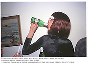 Lesley Smales drinking a beer. Don't  Hate Sculpt.  Bob & Roberta Smith private view. Chisenhale Gallery, London E3.12/9/97. Film 97268f8<br />© Copyright Photograph by Dafydd Jones<br />66 Stockwell Park Rd. London SW9 0DA<br />Tel 0171 733 0108