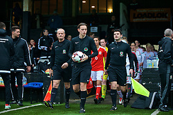 MERTHYR, WALES - Tuesday, February 14, 2017: Referee Matt Clarke leads out Wales and Hungary players before a Women's Under-17's International Friendly match at Penydarren Park. (Pic by Laura Malkin/Propaganda)