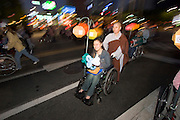 The annual Lotus Lantern Festival is held to celebrate Buddha's Birthday. The big lantern parade from Dongdaemun Stadium to Jogyesa temple. Buddhist monks rolling handicapped in wheel chair.