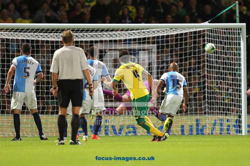 Bradley Johnson of Norwich City scores the winning goal to put his side 2-1 ahead during the Sky Bet Championship match against Blackburn Rovers at Carrow Road, Norwich<br /> Picture by Richard Calver/Focus Images Ltd +447792 981244<br /> 19/08/2014