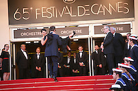 Actor Alec Baldwin carries Hilaria Thomas up thr red steps at the gala screening of the film Moonrise Kingdom at the 65th Cannes Film Festival. Wednesday 16th May 2012, the red carpet at Palais Des Festivals in Cannes, France.