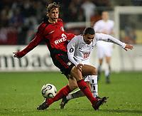 Photo: Paul Thomas.<br /> Bayer Leverkusen v Tottenham Hotspur. UEFA Cup. 23/11/2006.<br /> <br /> Aaron Lennon (R) of Spurs gets tackled by Stefan Kiebling.