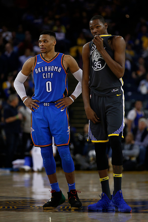 From left: Oklahoma City Thunder guard Russell Westbrook (0) and Golden State Warriors forward Kevin Durant (35) during the second half of an NBA game between the Warriors and Oklahoma City Thunder at Oracle Arena, Tuesday, Feb. 6, 2018, in Oakland, Calif. The Warriors lost 105-125.