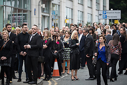 © Licensed to London News Pictures . 30/06/2017 . Stockport , UK . People queue outside . The funeral of Martyn Hett at Stockport Town Hall . Martyn Hett was 29 years old when he was one of 22 people killed on 22 May 2017 in a murderous terrorist bombing committed by Salman Abedi, after an Ariana Grande concert at the Manchester Arena . Photo credit : Joel Goodman/LNP