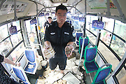 DALIAN, CHINA - AUGUST 16: (Image taken with fish-eye lens) <br /> <br /> Staffs of Dalian Public Transportation Group handle forged coins accumulated in a recent decade on August 16, 2016 in Dalian, Liaoning Province of China. About 670,000 forged coins collected from Dalian\'s public transportation fare like game coins, invalid foreign coins, counterfeit coins as well as others will be destroyed at a steel mill. ©Exclusivepix Media