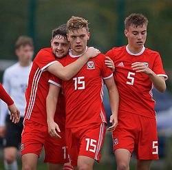 NEWPORT, WALES - Monday, October 14, 2019: Wales' Cameron Evans (C) celebrates scoring the first goal with team-mates Joe Adams (L) and Ryan Astley (R) during an Under-19's International Friendly match between Wales and Austria at Dragon Park. Wales won 2-0. (Pic by David Rawcliffe/Propaganda)