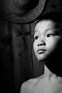 Kaili, Guizhou, China, August 10th 2007: Portrait of an 8 year old Miao boy..Photo: Joseph Feil