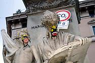 """Roma 5 Giugno 2008.  <br /> L' Associazione ambientalista  """"Terra""""  per protesta contro l'emissione di CO2, ha applicato  su 150 statue di Roma  mascherine antinquinamento e cartelli contro il CO2.<br /> Le Statue di Piazza San Pantaleo<br /> Rome June 5, 2008.  <br /> L 'Environmental association """"Earth"""" in protest against the emission of CO2, has applied to 150 statues of Rome anti-pollution masks and poster against the CO2.L"""