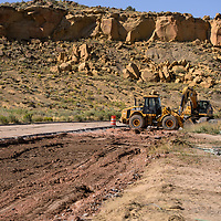 Heavy machinery removes the old, damage pavement from Metro Avenue in Gallup Wednesday as reconstruction on the roadway begins.