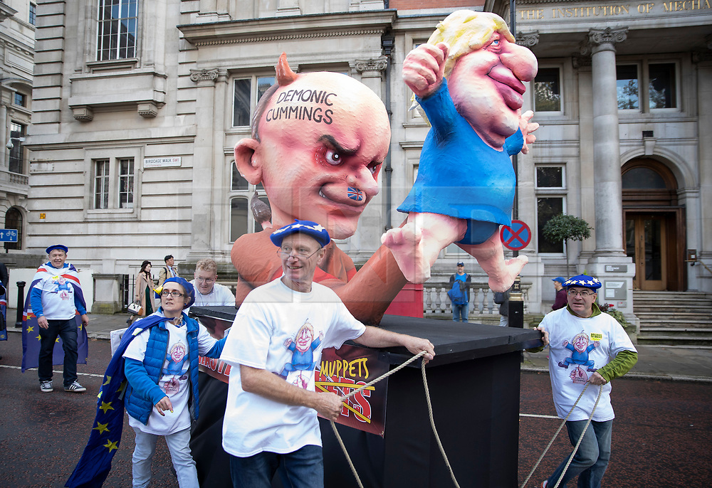 © Licensed to London News Pictures. 19/10/2019. London, UK. Ahead of the People's Vote March and rally an effigy of Prime Minister Boris Johnson and his special adviser Dominic Cummings is seen near Parliament. The Prime Minister's new Brexit deal will be debated and voted on in an historic Saturday sitting today. Photo credit: Peter Macdiarmid/LNP