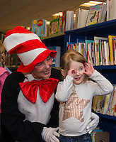 The Cat in the Hat visits Gilford Library during Read Across America day along with a birthday celebration for Dr. Seuss.  Karen Bobotas for the Laconia Daily Sun
