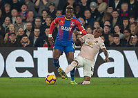 Football - 2018 / 2019 Premier League - Crystal Palace vs. Manchester United<br /> <br /> Ashley Young (Manchester United) times his tackle on Wilfried Zaha (Crystal Palace) at Selhurst Park.<br /> <br /> COLORSPORT/DANIEL BEARHAM